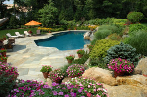 Swimming Pool With Pretty Gardens